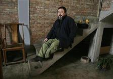 <p>Chinese contemporary artist Ai Weiwei speaks during an interview at his studio in Beijing March 1, 2010. REUTERS/Grace Liang</p>
