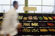 <p>A man walks past packaged fruit and vegetables during the opening ceremony for Tesco's Fresh & Easy Neighborhood supermarket in Los Angeles November 7, 2007. REUTERS/Lucy Nicholson</p>