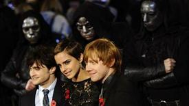 "<p>Britain's Emma Watson poses with Daniel Radcliffe (L) and Rupert Grint pose as they arrive for the world premiere of ""Harry Potter and the Deathly Hallows: Part 1"" at Leicester Square in London November 11, 2010. REUTERS/Dylan Martinez</p>"