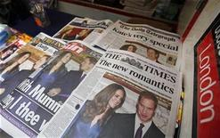 <p>Newspapers are displayed at a news stand, in London November 17, 2010. REUTERS/Suzanne Plunkett</p>