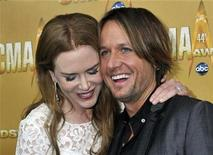 <p>Singer Keith Urban and wife, actress Nicole Kidman, arrive at the 44th annual Country Music Association Awards in Nashville, Tennessee in this November 10, 2010 file photos. REUTERS/Tami Chappell</p>