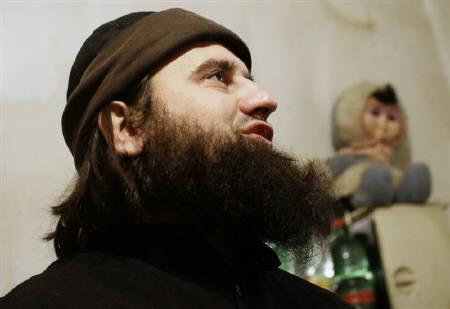 Bajram Asllani, 30, wanted by the FBI for allegedly conspiring to engage in violent jihad, is interviewed in his house in Mitrovica November 19, 2010. The United States considers lumberjack Asllani one of its most wanted men but, because of Kosovo's unusual international status, it is unable to extradite and interrogate him. REUTERS/Hazir Reka