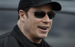 <p>Imagen de archivo del actor John Travolta, en una carrera de autos en Melbourne. Mar 27 2010 El actor John Travolta y su esposa, Kelly Preston, anunciaron el martes la llegada de su tercer hijo, un niño que nace dos años después de la muerte de su primogénito Jett. REUTERS/Mick Tsikas/ARCHIVO</p>