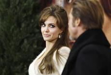 "<p>Cast member Angelina Jolie arrives with Brad Pitt for the premiere of ""The Tourist"" in New York December 6, 2010. REUTERS/Lucas Jackson</p>"