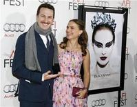 "<p>Director Darren Aronofsky (L) and cast member Natalie Portman pose together before a screening of the film ""Black Swan"" at the closing night gala of AFI Fest 2010 in Hollywood, California November 11, 2010. REUTERS/Danny Moloshok</p>"