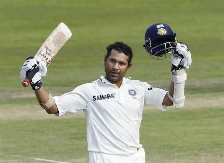 Sachin Tendulkar celebrates his century against South Africa on the fourth day of the first cricket test match in Pretoria, December 19, 2010. REUTERS/Mike Hutchings