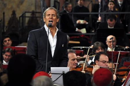 Michael Bolton sings during a traditional Christmas concert in the frescoed basilica of St Francis of Assisi, central Italy, December 19, 2010. REUTERS/Stringer