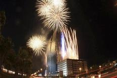 <p>Fireworks explode above a giant video screen in Jeddah December 8, 2010. REUTERS/Susan Baaghil</p>