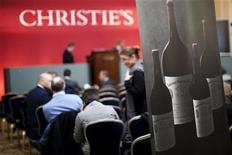 <p>People attend the fine wine auction at Christie's in Geneva in this November 16, 2010 file photo. REUTERS/Valentin Flauraud</p>