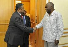 <p>African Union Commission Chairperson Jean Ping (L) shakes hands with Ivory Coast President Laurent Gbagbo at his private residence in Abidjan December 17, 2010. REUTERS/Stringer</p>