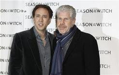 "<p>Cast members Nicolas Cage (L) and Ron Perlman pose as they arrive for the premiere of the film ""Season of the Witch"" in New York January 4, 2011. REUTERS/Lucas Jackson</p>"