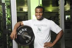 """<p>Personal trainer and author of """"FitTionary: The Beginner's Fitness and Nutrition Guide to Staying in Shape on Campus"""" Nduka Anyanwu poses for a picture at Clarkson University Fitness Center in Potsdam, New York in this handout picture taken September 2010. REUTERS/Christopher Lenney/Handout</p>"""