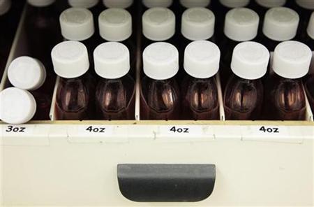 Bottles for holding prescription medication rest in a shelf at a pharmacy in New York December 23, 2009. REUTERS/Lucas Jackson