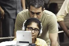 "<p>Bollywood actor Aamir Khan (top) and director Kiran Rao are shown on the set of Rao's film ""Dhobi Ghat"" (Mumbai Diaries) in this publicity photo released to Reuters January 21, 2011. Rao, the wife of Indian superstar Aamir Khan, explores the burgeoning city of Mumbai through complex relationships of its disparate residents in ""Dhobi Ghat,"" which opened in India and parts of the United States on Friday and is expected to play around the world in coming weeks and months. It had its world premiere at September's Toronto International Film Festival and also played at the London Film Festival. REUTERS/UTV/Handout</p>"