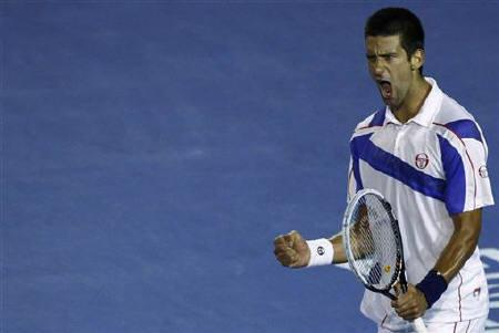 Novak Djokovic of Serbia reacts in his semi-final match against Roger Federer of Switzerland at the Australian Open tennis tournament in Melbourne January 27, 2011. REUTERS/Mick Tsikas