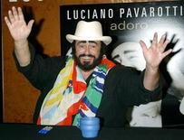 """<p>Legendary Tenor Luciano Pavarotti signed copies of """"Ti Adoro,"""" his CD released by Decca Records on October 2, 2003, at Tower Records in New York. REUTERS/Ken Katz</p>"""