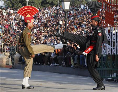 A Pakistani Ranger (R) and an Indian Border Security Force officer goose-step during the daily parade at their joint border post of Wagah near Lahore, February 10, 2011. REUTERS/Mohsin Raza