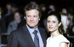 <p>Actor Colin Firth (L) and his wife Livia popse for photographers as they arrive for the London Film Critics' Circle Awards in London, February 10, 2011. REUTERS/Paul Hackett</p>