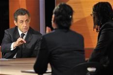 <p>France's President Nicolas Sarkozy answers questions from some of nine citizens on jobs, security, care of the elderly and other domestic concerns in a live broadcast at French TF1 television studios in Paris February 10, 2011. REUTERS/Philippe Wojazer</p>