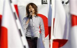 <p>Political activist Tsunehira Furuya, 28, speaks on a podium during a rally to protest against Japan's Prime Minister Naoto Kan in Tokyo's Shibuya district December 18, 2010. The fracturing of the post-World War Two system that propelled Japan's economy to the No.2 global spot -- a status now lost to China -- has pushed many youths to seek security by trying to cling to what remains. But for others, the uncertainty itself is giving birth to a do-it-yourself mindset that could generate welcome dynamism. REUTERS/Toru Hanai</p>