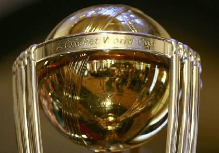 Photographers are reflected in the trophy for the Cricket World Cup 2011 during a conference in Colombo April 2, 2010. The website selling just 1000 tickets for the World Cup final in Mumbai's Wankhede Stadium on April 2 crashed seconds after they went on sale on Monday sparking furious complaints from fans.  REUTERS/Andrew Caballero-Reynolds/Files
