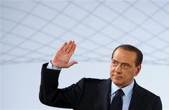 <p>Italian Prime Minister Silvio Berlusconi waves as he arrives to deliver a speech during a two-day event in the city of Rome February 23, 2011. REUTERS/Remo Casilli</p>