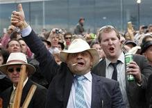 <p>A race-goer cheers as jockey Gerald Mosse of France rides Americain to victory in the Melbourne Cup at the Flemington Racecourse in Melbourne November 2, 2010. REUTERS/Mick Tsikas</p>
