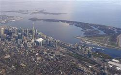 <p>The Toronto Island Airport (R) sits next to the downtown core of Toronto in Lake Ontario in a picture taken from a commercial flight over the city November 6, 2010. REUTERS/Gary Hershorn</p>