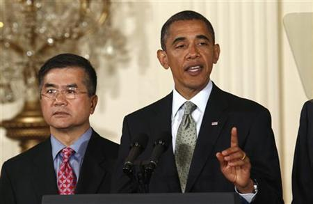 President Barack Obama makes remarks on export promotion to grow the economy from the White House in Washington July 7, 2010, alonside Commerce Secretary Gary Locke. REUTERS/Kevin Lamarque