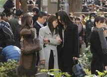 <p>Evacuees stand around Shinjuku Central Park in Tokyo Japan March 11, 2011. REUTERS/KYODO</p>
