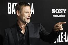 """<p>Cast member Aaron Eckhart poses at the premiere of """"Battle: Los Angeles"""" at the Regency Village theatre in Los Angeles March 8, 2011. The movie opens in the U.S. on March 11. REUTERS/Mario Anzuoni</p>"""