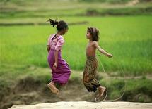 <p>Rohingya children from Myanmar play in a refugee camp in Cox's Bazaar August 17, 2009. REUTERS/Andrew Biraj</p>