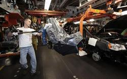 <p>A Chrysler auto worker uses an ergo-arm to load the seats into Chrysler minivans during the production launch of the new 2011 Dodge Grand Caravan's and Chrysler Town & Country minivans at the Windsor Assembly Plant in Windsor, Ontario January 18, 2011. REUTERS/Rebecca Cook</p>