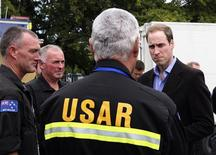 <p>Britain's Prince William speaks with members of the Urban Search and Rescue team in Christchurch March 17, 2011. Prince William is visiting New Zealand until March 19. REUTERS/Mark Taylor/Pool</p>