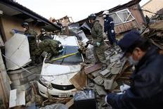 <p>Members of Japan's Self-Defense Forces try to recover the body of a victim found in a car amidst the ruins of a destroyed residential area in Kesennuma, Miyagi Prefecture, more than a week after the area was devastated by a magnitude 9.0 earthquake and tsunami, March 19, 2011. REUTERS/Damir Sagolj</p>