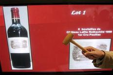 <p>The auctioneer's hammer of Dominique Giafferi is seen during a vintage wine auction from the grand cellar of Paris City Hall at the Credit Municipal in Paris, October 20, 2006. REUTERS/Benoit Tessier</p>