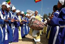 """<p>Ethiopians chant and dance at a celebration to mark """"Timket"""", the Ethiopian Orthodox festival of Epiphany, in the capital Addis Ababa January 19, 2006. [The occasion marks the appearance of Jesus Christ in the world, covering everything from his birth to his baptism by John the Baptist].</p>"""