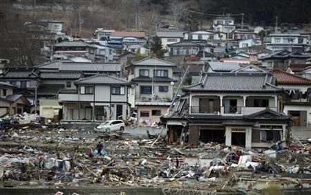 A man cleans an area destroyed by the earthquake and tsunami near Yamada town, Iwate Prefecture in northern Japan, March 24, 2011. REUTERS/Carlos Barria