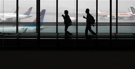 Passengers walk after landing at Guarulhos Airport in Sao Paulo, in this March 4, 2011 file photo. REUTERS/Nacho Doce