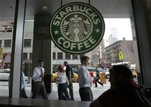 <p>Poeple walk past the Starbucks outlet on 47th and 8th Avenue in New York June 29, 2010. REUTERS/Lily Bowers</p>