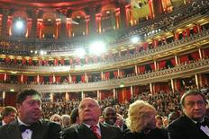 <p>Former Soviet President Mikhail Gorbachev (2nd L) sits with his daughter Irina during a concert in his honour, at the Royal Albert Hall in London March 30, 2011. Movie stars, singers and politicians turned out on Wednesday for a gala concert in London to honour former Soviet President Gorbachev, who celebrated his 80th birthday earlier this month. REUTERS/Toby Melville</p>