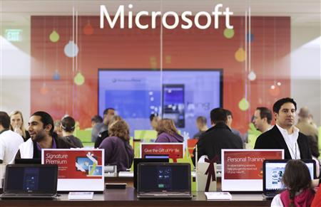 Customers shop at the new Microsoft store in Bellevue, Washington in this November 18, 2010 file photo. Microsoft Corp stepped up its rivalry with Google Inc with a formal complaint on March 31, 2011 to EU antitrust regulators, claiming Google systematically thwarts Internet search competition. It is the first time Microsoft - itself the target of anti-competition action in the United States and Europe - has filed a complaint with regulators over competition issues. REUTERS/Marcus Donner/Files