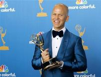 "<p>Ryan Murphy poses with his award for outstanding writing for a comedy series for ""Glee"" at the 62nd annual Primetime Emmy Awards in Los Angeles, California August 29, 2010. REUTERS/Danny Moloshok</p>"