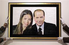 "<p>A painting called "" Silvio & Ruby"" made with plastic bags and scotch tape by Israeli artist Dodi Reifenberg is displayed at the Edward Cutler gallery in Milan April 6, 2011. REUTERS/Alessandro Garofalo</p>"