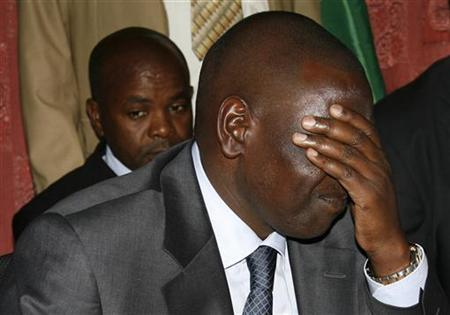 Kenya's suspended Higher Education Minister William Ruto (L) sits in Kenya's High Court in the capital Nairobi October 26, 2010. REUTERS/Noor Khamis
