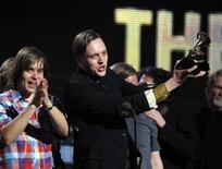 "<p>Edwin Butler of Canadian band Arcade Fire holds up the Grammy for Album of the Year for ""The Suburbs"" at the 53rd annual Grammy Awards in Los Angeles, California February 13, 2011. REUTERS/Lucy Nicholson</p>"