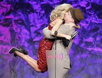 <p>Actress Kristin Chenoweth is lifted off her feet as she gets a hug as she accepted the Vanguard Award from actor Sean Hayes at the 22nd annual Gay and Lesbian Alliance Against Defamation (GLAAD) Media Awards in Los Angeles, April 10, 2011. REUTERS/Fred Prouser</p>