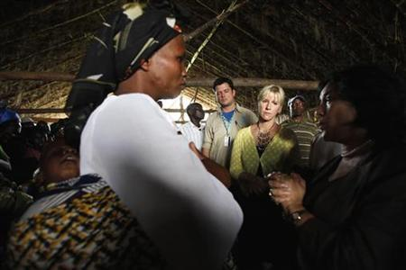 Margot Wallstrom (2nd R), the UN's special representative on sexual violence, listens to villagers in Kitchanga, in eastern Democratic Republic of Congo, October 3, 2010. REUTERS/Katrina Manson