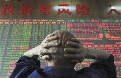 <p>An investor looks at an electronic board showing stock information at a brokerage house in Taiyuan, Shanxi province, June 19, 2008. REUTERS/China Daily</p>