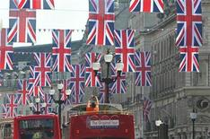 <p>A tourist photographs Union flags hung along Regent Street in celebration of the forthcoming royal wedding between Prince William and Kate Middleton in London April 19, 2011. REUTERS/Toby Melville</p>
